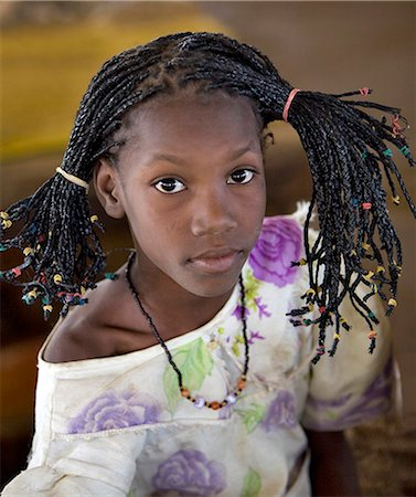 Mali,Gao. A young Songhay girl at Gao market with a fetching modern hairstyle. Stock Photo - Rights-Managed, Code: 862-03364171