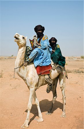 desert people dress photos - Mali,Timbuktu. Tuareg camel riders near Timbuktu. Stock Photo - Rights-Managed, Code: 862-03364232