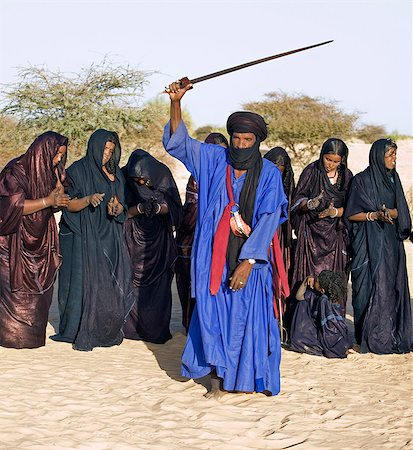 desert people dress photos - Mali,Timbuktu. A group of Tuareg men and women sing and dance near their desert home,north of Timbuktu. Stock Photo - Rights-Managed, Code: 862-03364259