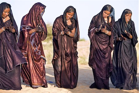 desert people dress photos - Mali,Timbuktu. Tuareg women sing and dance near their desert home,north of Timbuktu. Stock Photo - Rights-Managed, Code: 862-03364261
