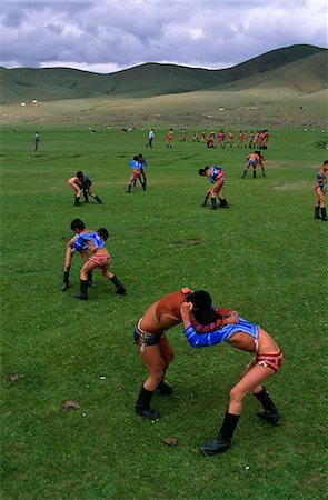Mongolia,Ulan Bator. Boys competing in a wrestling competition at the National Day (Naadam) celebrations known as the 'three manly games'. Stock Photo - Rights-Managed, Code: 862-03364539