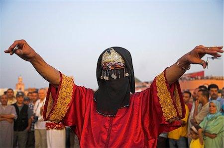 A traditional transvestite dancer performs in the Djemaa el Fna,Marrakech. Stock Photo - Rights-Managed, Code: 862-03364748