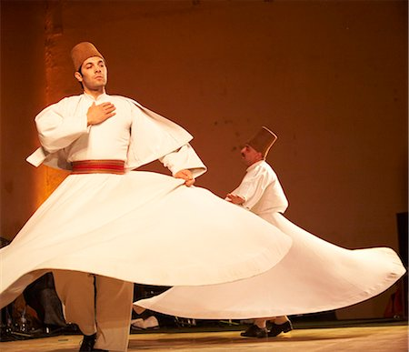 Morocco,Fes. Two whirling Dervishes perform during a concert at the Fes Festival of World Sacred Music. Members of the Al Kindi Ensemble perform the music. Stock Photo - Rights-Managed, Code: 862-03364820