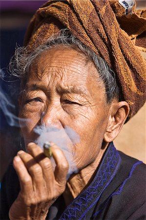 Myanmar,Burma,Lake Inle. An old Pa-O woman smokes a cheroot. Stock Photo - Rights-Managed, Code: 862-03365179