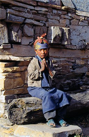 Nepalese girl bidding Namaste (Welcome),Manang Stock Photo - Rights-Managed, Code: 862-03365417