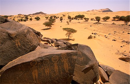 prehistoric - Niger,Tenere Desert. Rock Art thought to be 30,000 years old found near the Oasis of Tezizet. Stock Photo - Rights-Managed, Code: 862-03365489