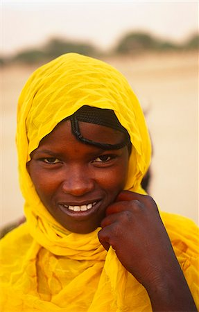 Niger,Timia Oasis. Local Tuareg woman. Traditionally,Muslim Tuareg women do not wear veils but the men keep their faces covered. Stock Photo - Rights-Managed, Code: 862-03365497