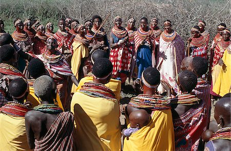 During Samburu wedding celebrations,married women congregate apart from the warriors and young girls to sing in praise of the couple and to dance. Stock Photo - Rights-Managed, Code: 862-03366055