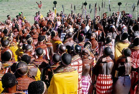 The invited guests at a Samburu wedding gather together to sing in praise of the couple and to dance. Celebrations will go on late into the night. Stock Photo - Rights-Managed, Code: 862-03366057