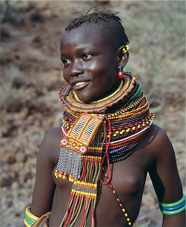 A young Turkana girl adorned with necklaces of a style the Southern Turkana prefer to wear. Stock Photo - Rights-Managed, Code: 862-03366113