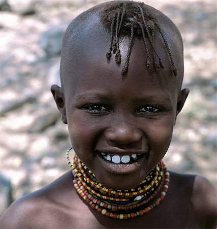 A young Turkana girl with her head shaved except for a tuft,which is braided. This is the usual hairstyle for women and girls. Stock Photo - Rights-Managed, Code: 862-03366122