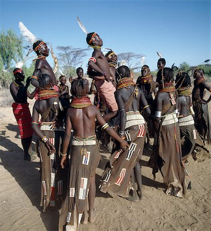 Song is an art form ingrained in Turkana culture. At the end of a dance session,the participants invariably enjoy the Song of the Bulls. Each young man will take centre-stage to extol the praises of his favourite ox. He will explain how it came into his possession,its distinguishing traits and with outstretched arms,imitate the shape of its horns. Stock Photo - Rights-Managed, Code: 862-03366135
