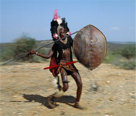 A Maasai warrior in full battle cry,his long-bladed spear at the ready. Stock Photo - Rights-Managed, Code: 862-03366147