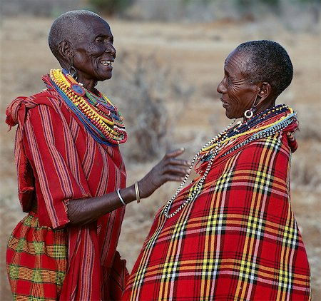Two Maasai women in traditional attire chat to each other. Stock Photo - Rights-Managed, Code: 862-03366169