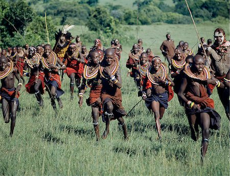 A jovial group of Maasai girls are chased by warriors during a ceremony. Stock Photo - Rights-Managed, Code: 862-03366176