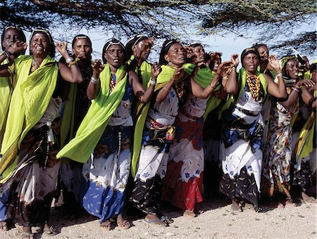 Gabbra women sing and dance to celebrate a wedding. The traditional metal ornamentation on their heads is called malmal. Stock Photo - Rights-Managed, Code: 862-03366405