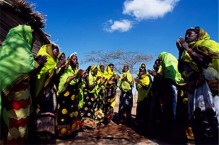 Gabbra women dance at a gathering in the village of Kalacha. The Gabbra are a Cushitic tribe of nomadic pastoralists living with their herds of camels and goats around the fringe of the Chalbi Desert. Stock Photo - Rights-Managed, Code: 862-03366480
