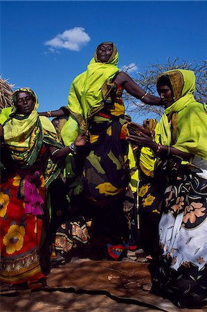 Gabbra women dance at a gathering in the village of Kalacha. The Gabbra are a Cushitic tribe of nomadic pastoralists living with their herds of camels and goats around the fringe of the Chalbi Desert. Stock Photo - Rights-Managed, Code: 862-03366481
