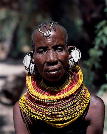 An old Turkana woman,typically wearing many layers of bead necklaces and a series of hooped earrings with an pair of leaf-shaped earrings at the front. Stock Photo - Rights-Managed, Code: 862-03366493