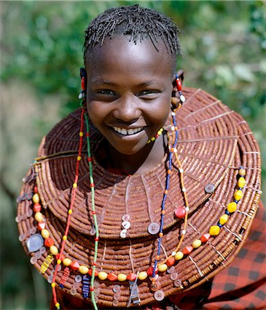 A young Pokot girl wears large necklaces made from the stems of sedge grass,which are then plastered with a mixture of animal fat and red ochre before being decorated with buttons and beads. Stock Photo - Rights-Managed, Code: 862-03366603