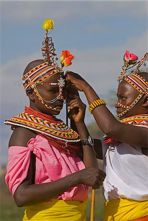 Two young Samburu girls help each other preparing for a celebration,Wamba District,Kenya Stock Photo - Rights-Managed, Code: 862-03366627