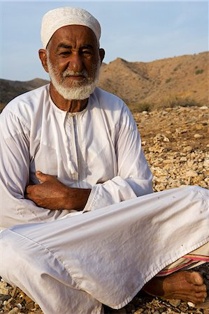 Oman,Muscat Region,Bandar Khayran. A old farmer sits down for a chat dressed in traditional Omani clothing. Stock Photo - Rights-Managed, Code: 862-03360335