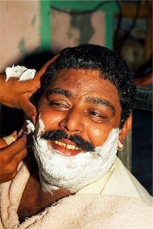 punjabi - A close shave: most men in Pakistan visit a barber several times each week. Stock Photo - Rights-Managed, Code: 862-03360410