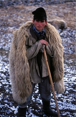 stave - Local shepherd with traditional sheep skin coat and dog Stock Photo - Rights-Managed, Code: 862-03360981