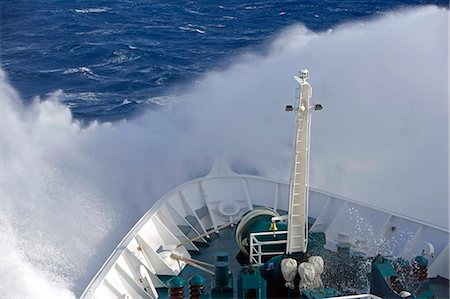 sailing boat storm - Antarctica,Antarctic Peninsula,Drakes Passage. Running into heavy seas,the bow of the expedition ship MV Discovery cut a path through the deep blue sea separating the southern continent from South America. Stock Photo - Rights-Managed, Code: 862-03436895