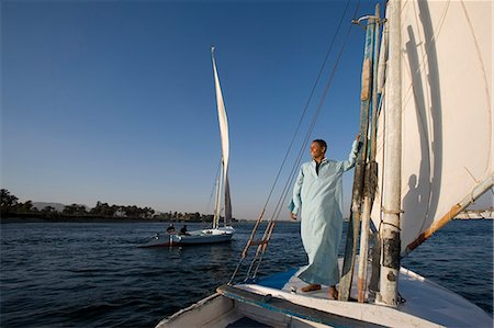 Feluccas sailing on the Nile at Luxor,Egypt Stock Photo - Rights-Managed, Code: 862-03437024