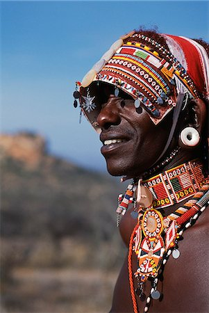 Elaborate headdress and body adornments worn by Samburu moran (warrior). Stock Photo - Rights-Managed, Code: 862-03437153