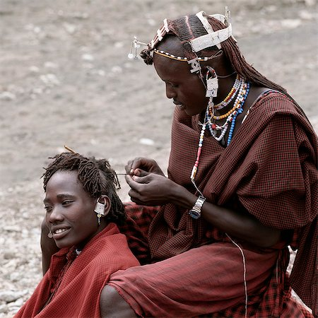 Maasai warriors take enormous trouble over their appearance especially their long hair,which is braided,Ochred and decorated with beaded ornaments. This singular hairstyle sets them apart from the rest of their community. Stock Photo - Rights-Managed, Code: 862-03437400