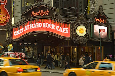 restaurant new york manhattan - New York City cabs pass in front of the Hard Rock Cafe at Times Square Stock Photo - Rights-Managed, Code: 862-03437427
