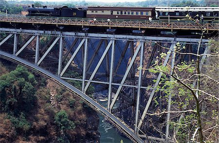 steam engine - Steam train going over Victoria falls suspension bridge. Stock Photo - Rights-Managed, Code: 862-03438087
