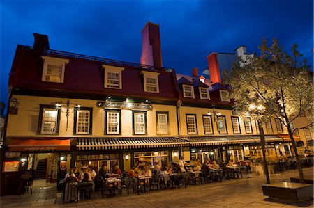 Quebec City, Canada. Crowds on the street and dining on the patio of the Auberge du Tresor Stock Photo - Rights-Managed, Code: 862-03710667