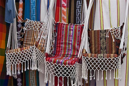 Ecuador, Market stalls selling brightly-coloured, locally-made hanging chairs at Otavalo. Stock Photo - Rights-Managed, Code: 862-03710879