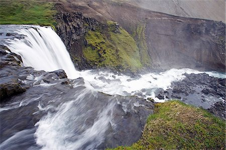 Iceland. The active tectonic nature of the interior of Iceland has resulted in a landscape dotted with spectacular waterfalls,such as this one viewed from the top near Laugavegur. Stock Photo - Rights-Managed, Code: 862-03711807
