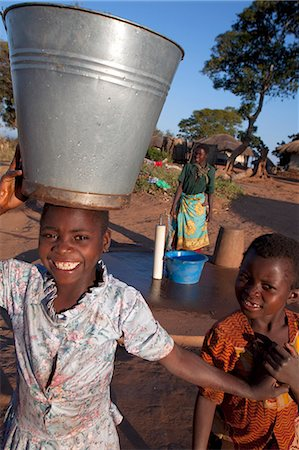 Malawi, Lilongwe, Ntchisi Forest Reserve. With a clean water supply villagers gather to collect water Stock Photo - Rights-Managed, Code: 862-03713100