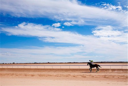 Australia, Queensland, Birdsville.  A horse rider on the dirt track at Birdsville during the annual Birdsville Cup races. Stock Photo - Rights-Managed, Code: 862-03736213