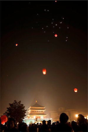 release - China, Shaanxi Province, Xian, lanterns being released into the sky on New Years Eve Stock Photo - Rights-Managed, Code: 862-03736505