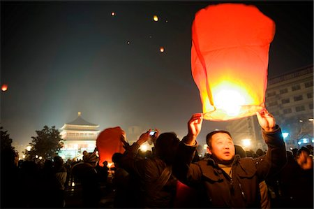 release - China, Shaanxi Province, Xian, lanterns being released into the sky on New Years Eve Stock Photo - Rights-Managed, Code: 862-03736506