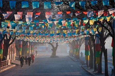 China, Hebei Province, Chengde, Tibetan prayer flags lining a street Stock Photo - Rights-Managed, Code: 862-03736563