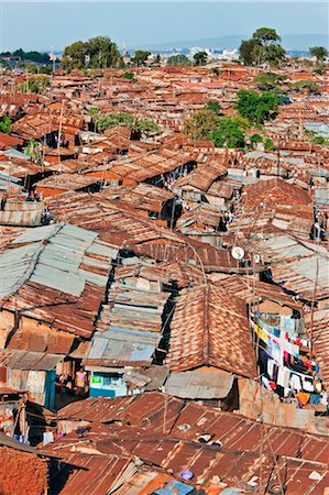 settlement - Kenya, Nairobi. A crowded part of Kibera, one of Nairobi s largest slums, with the city centre visible in the distance Stock Photo - Rights-Managed, Code: 862-03736764