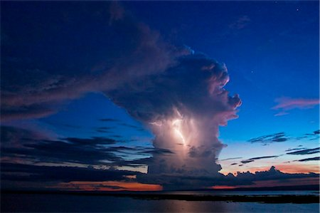 storm lightning - Kenya, Nyanza District. A violent evening storm with forked lightning over Lake Victoria . Stock Photo - Rights-Managed, Code: 862-03736813