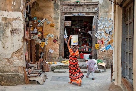 Tanzania, Zanzibar, Stone Town. A general store in one of Stone Town s maze of narrow streets. Car number plates for sale. Stock Photo - Rights-Managed, Code: 862-03737259