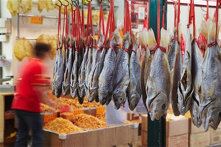 Dried fish hanging outside seafood shops, Des Voeux Road West, Sheung Wan, Hong Kong, China Stock Photo - Rights-Managed, Code: 862-03731089
