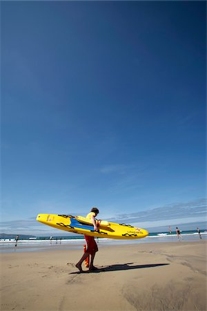 England; Cornwall. Beach lifeguard on Gwithian Sands, near Hayle. Stock Photo - Rights-Managed, Code: 862-03731252
