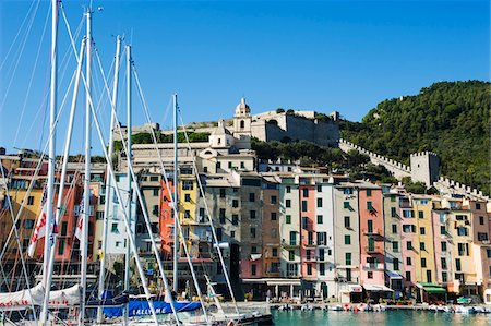 european hillside town - Italy, Liguria, Cinque Terre, Porto Venere, waterfront pastel coloured houses and harbour Stock Photo - Rights-Managed, Code: 862-03731438