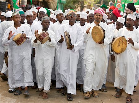 Kenya. A joyful Muslim procession during Maulidi, the celebration of Prophet Mohammed s birthday. Stock Photo - Rights-Managed, Code: 862-03731554