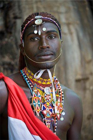 Kenya, Laikipia, Lewa Downs.  A Laikipiak Maasai warrior or moran in traditional dress. Stock Photo - Rights-Managed, Code: 862-03731609